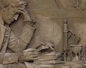 Bas Relief Carved in Stone - Troubled Reader with Candle
