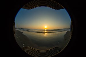 Glass Orb Sandbox with Sunrise over Ocean